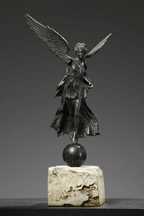 An Italian patinated bronze model of a winged Victory,
