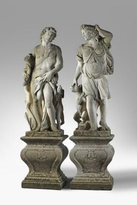 A pair of Italian sculpted limestone garden models of