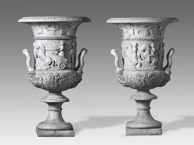 A pair of monumental Italian sculpted white marble urns