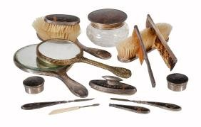 A collection of silver and tortoiseshell pique dressing