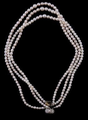 A three strand cultured pearl necklace, the three