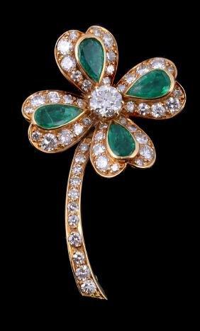 A diamond and emerald four leaf clover brooch