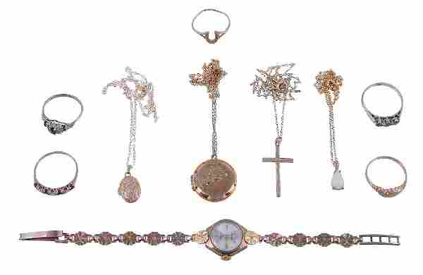 A small collection of gold coloured jewellery , to