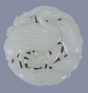 A Chinese white jade 'egret and lotus' pendant
