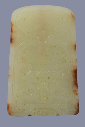 A Chinese yellow and brown jade pendant or ceremonial