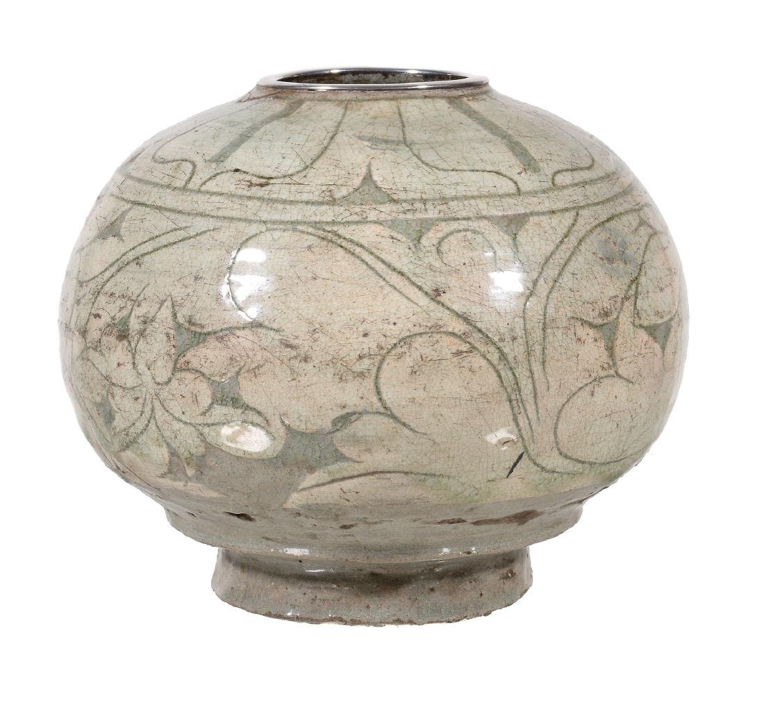 A Buncheong type stoneware vase, of ovoid form