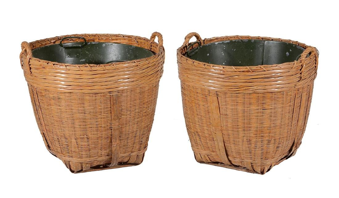 A pair of wicker log baskets, with loop handles and
