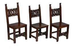 A set of three North Italian walnut side chairs  17th