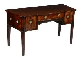 A George III mahogany serpentine sideboard, attributed