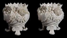A pair of Belleek spirally-fluted, shell-moulded and
