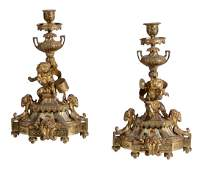 A pair of Continental gilt metal candlesticks, late