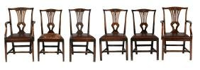 A set of seven mahogany dining chairs including a pair