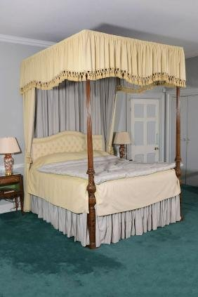 A mahogany four poster bed, 19th century with later