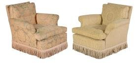 A pair of upholstered armchairs in the manner of Howard