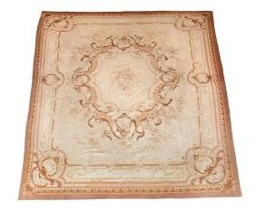 A French Aubusson carpet , circa 1870, ivory field with