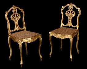 A pair of gilt wood side chairs,