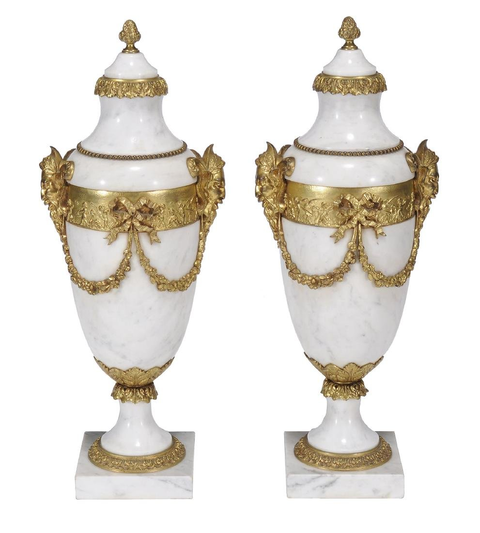 A pair of Continental mottled white marble and gilt