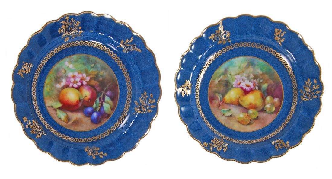 A pair of Royal Worcester powder-blue-ground plates