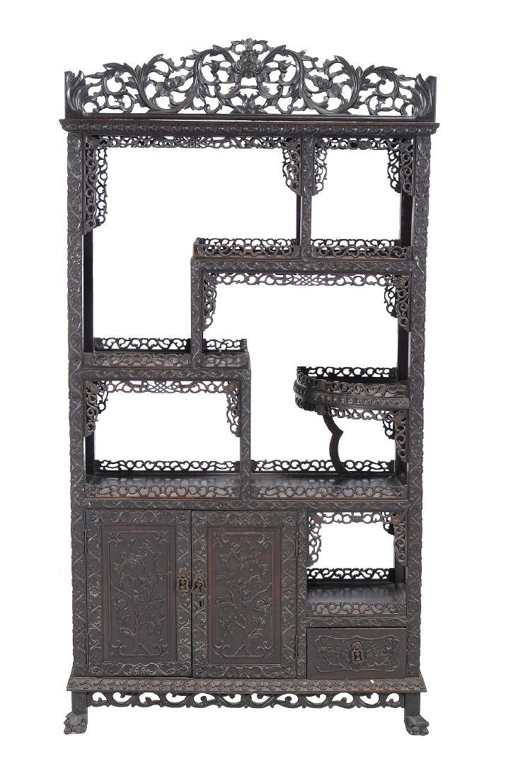 A Chinese carved hardwood open display cabinet, late