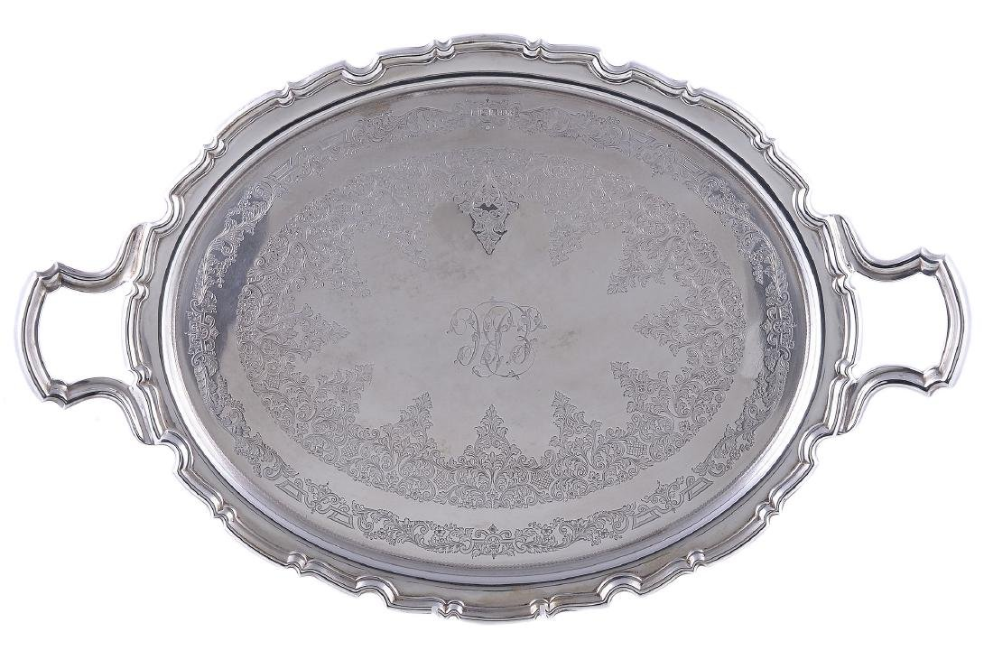 An Edwardian silver shaped oval twin handled tray by