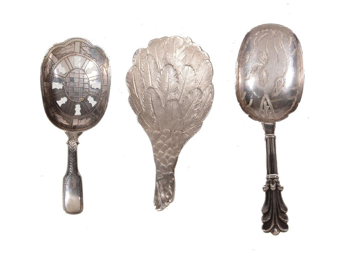 Three silver caddy spoons, comprising: a late George