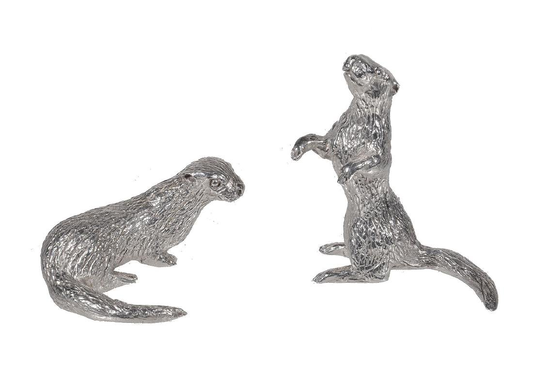 A pair of silver models of otters by D. J