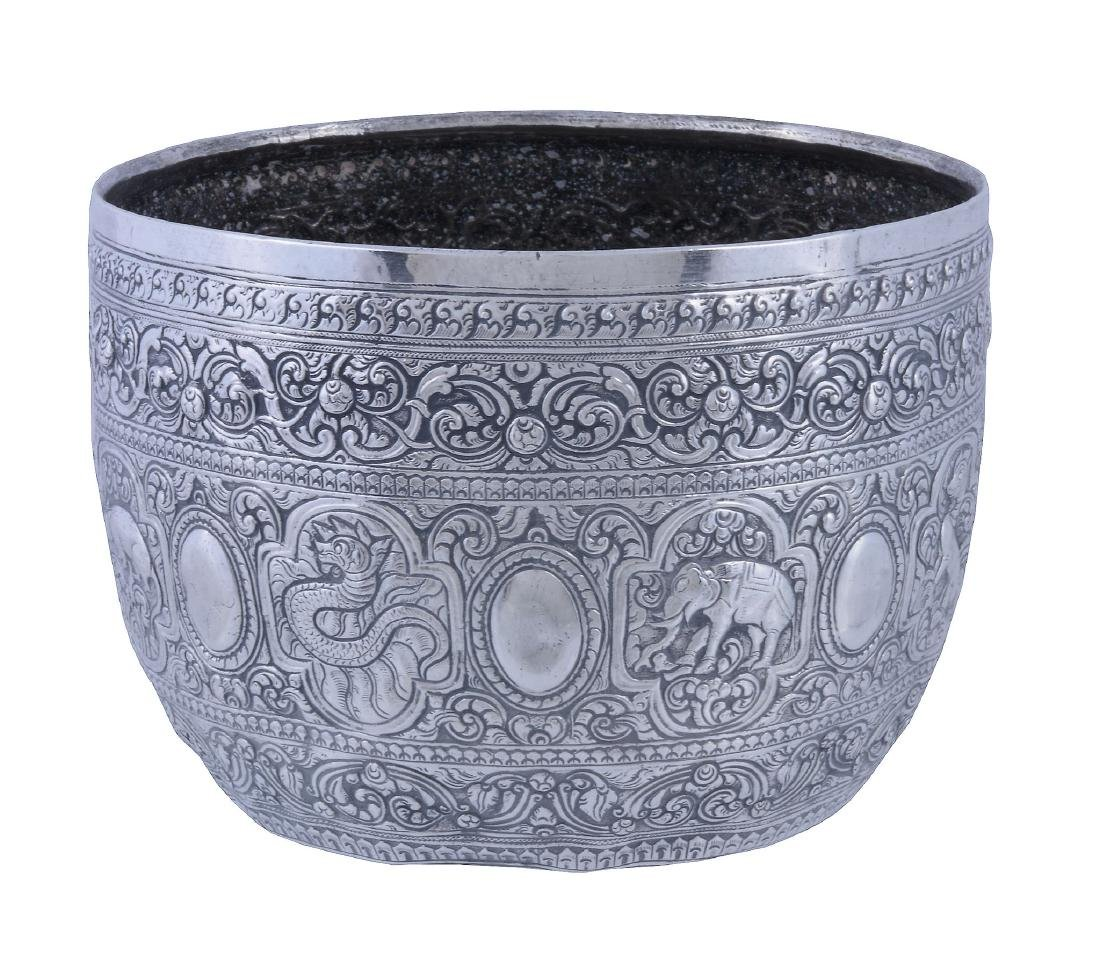 A Burmese silver bowl, circa 1900, chased with a band