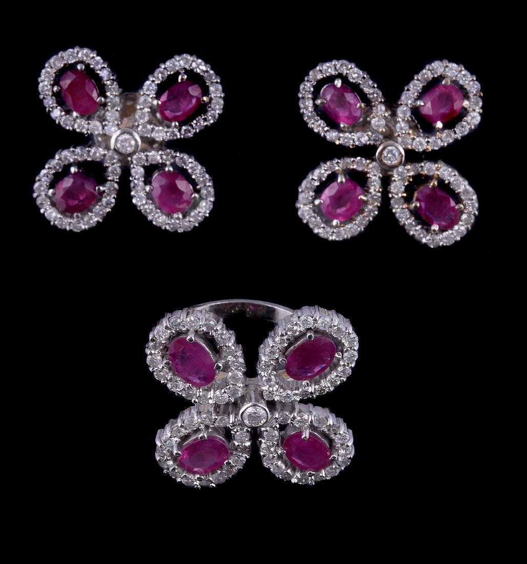 A ruby and diamond ring and pair of earrings