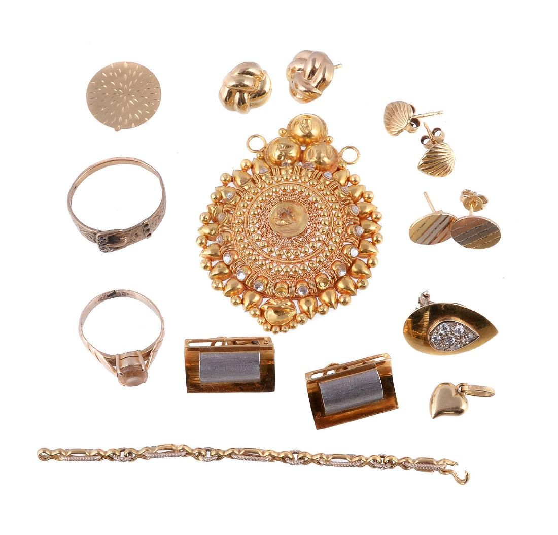 A small collection of gold coloured jewellery