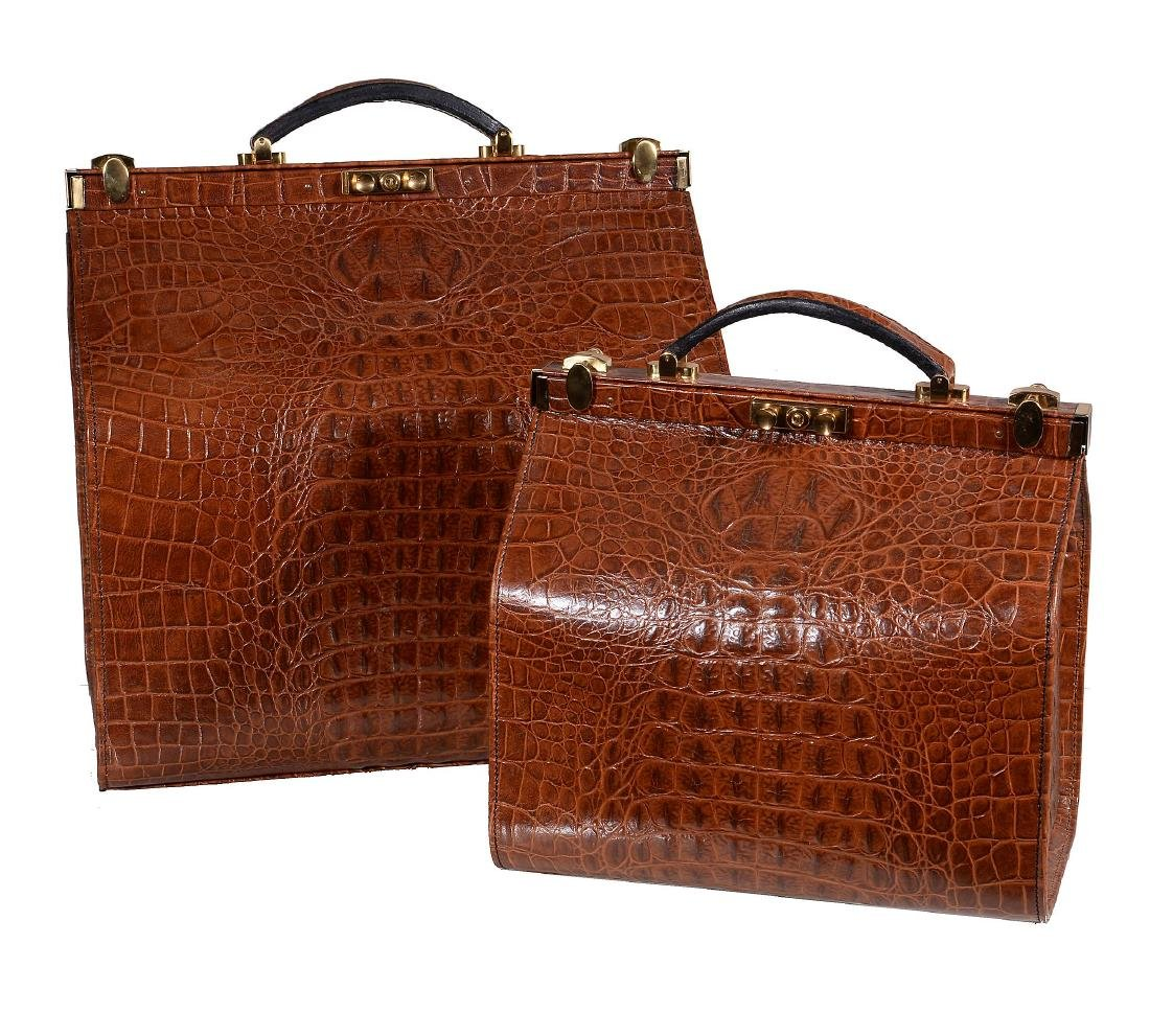 A graduated pair of Gladstone type leather bags, late
