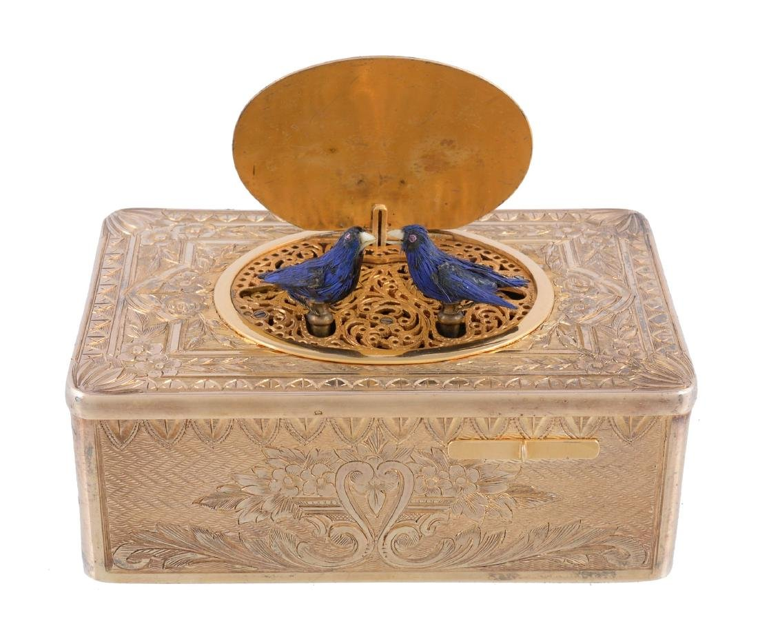 A rare French silver cased double singing bird musical