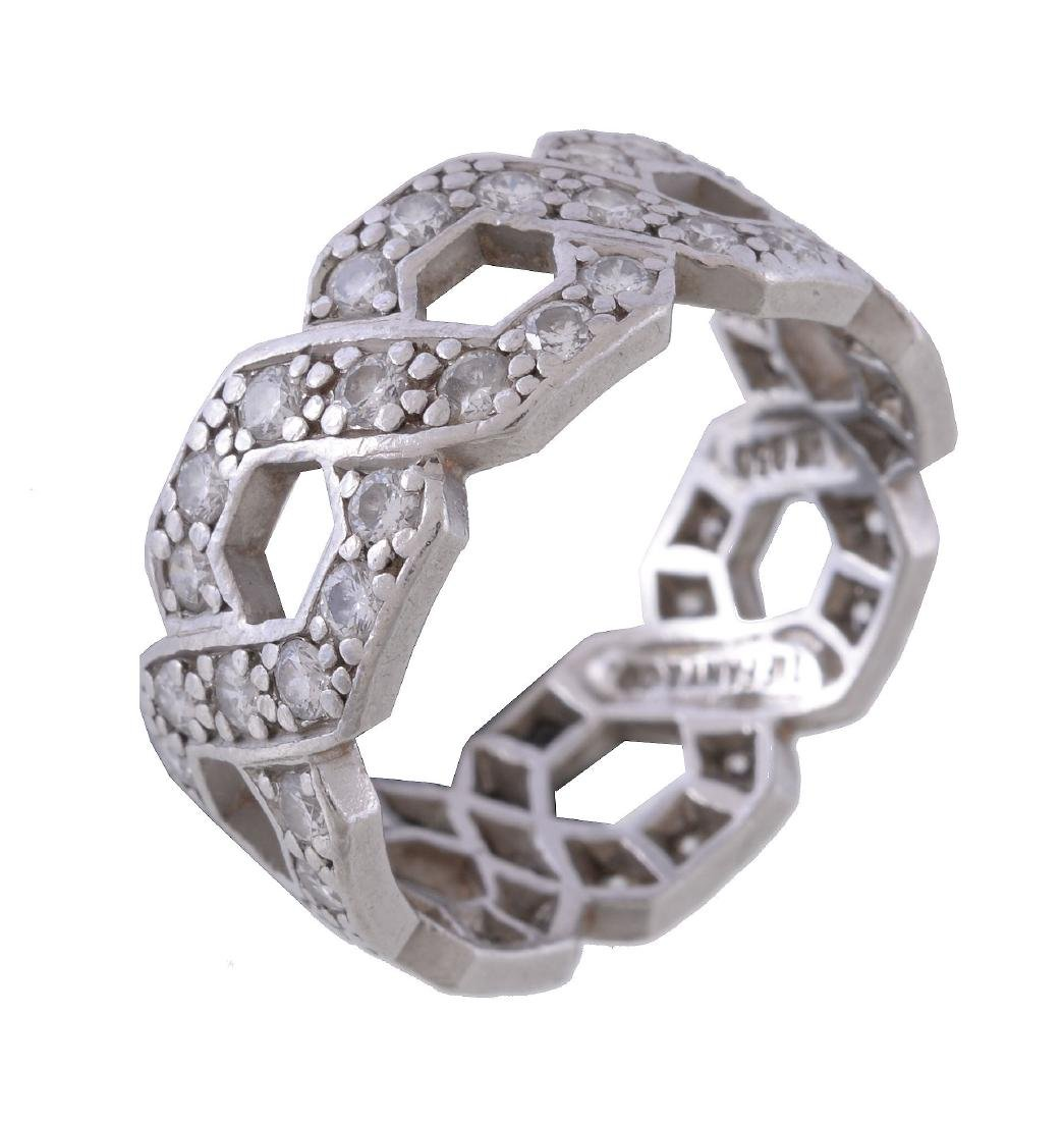 A diamond band ring by Tiffany & Co., the interlinking