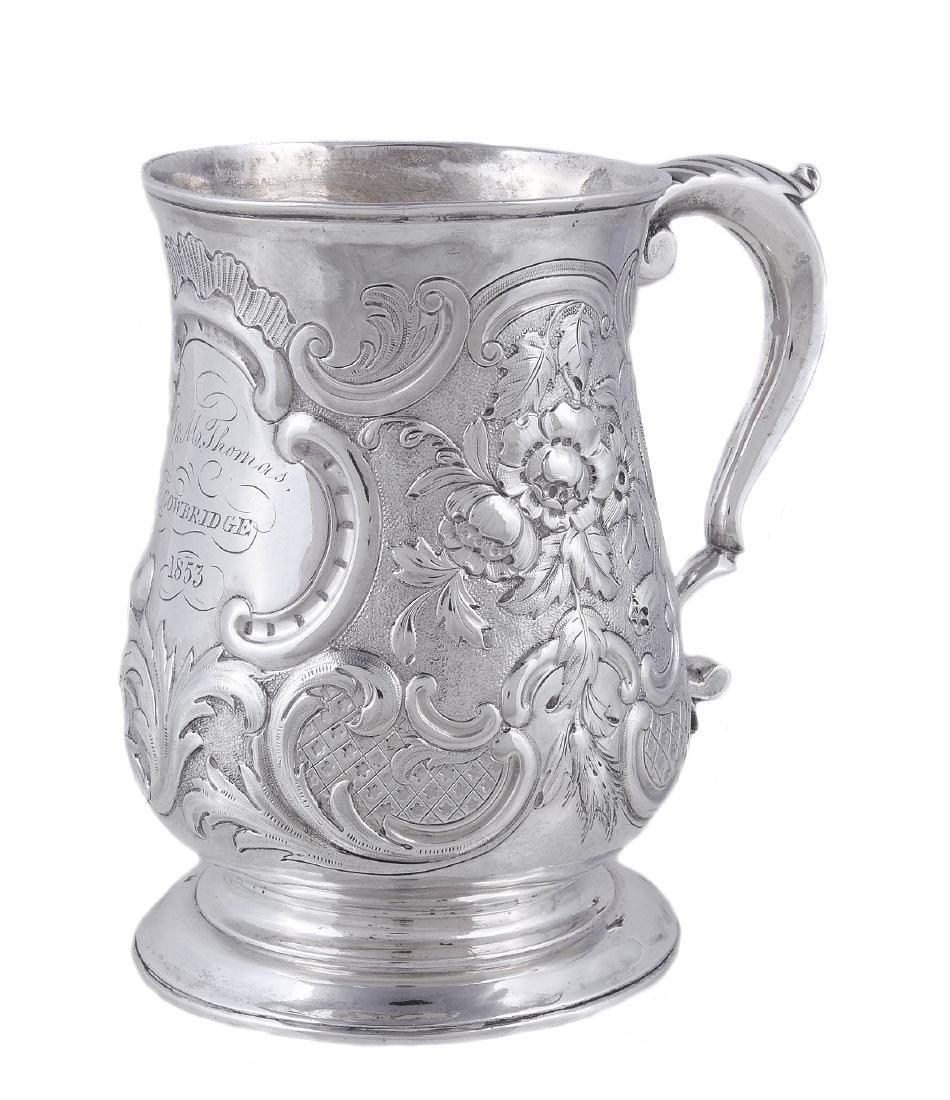 A late George II silver baluster mug by William Shaw &