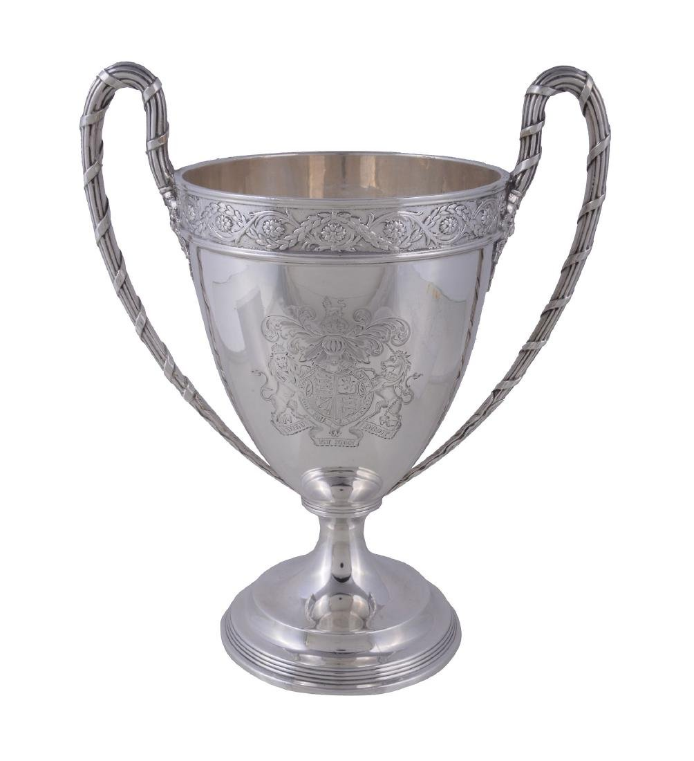 A silver twin handled pedestal cup by West & Son of