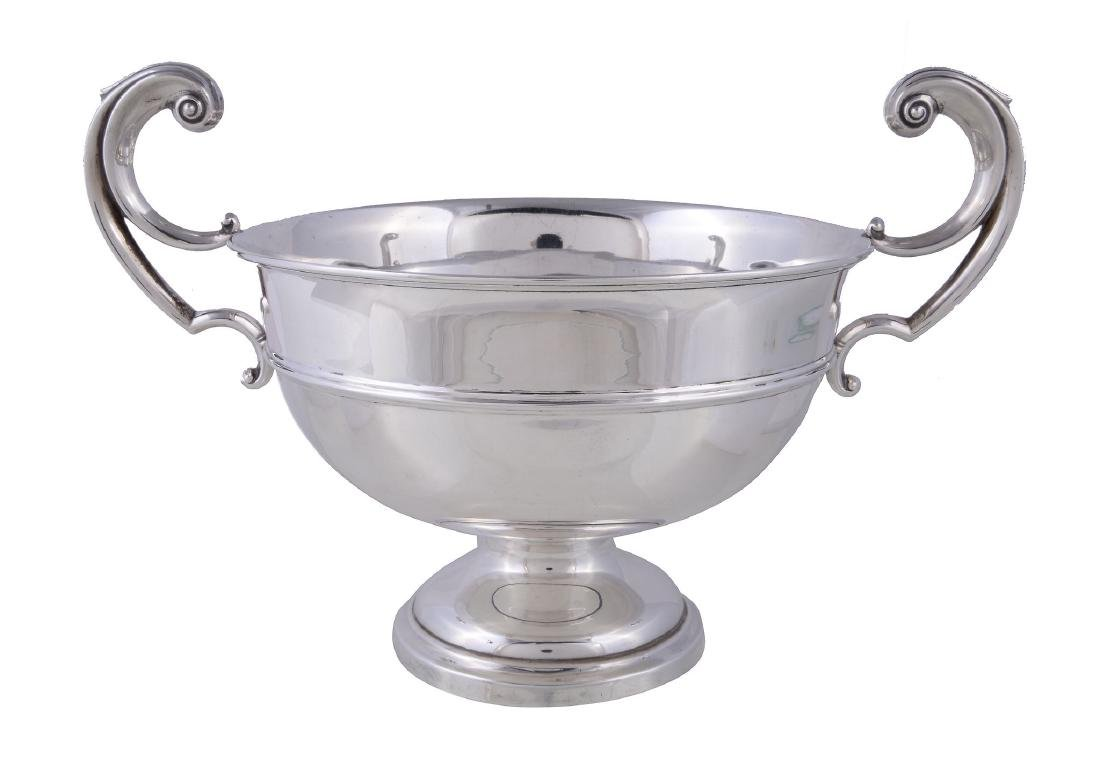 A silver twin handled trophy cup by Levesley Brothers,