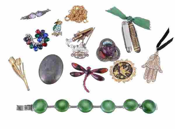 A gold coloured hand of Fatima pendant, the filigree