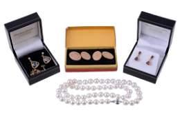 A pair of 9 carat gold moonstone earrings