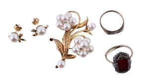 A cultured pearl brooch designed as a foliate spray