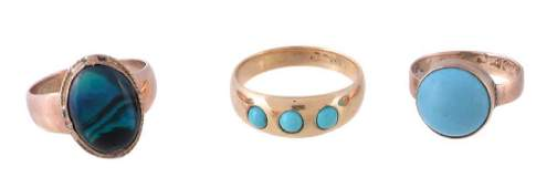 A three stone turquoise ring set with three circular