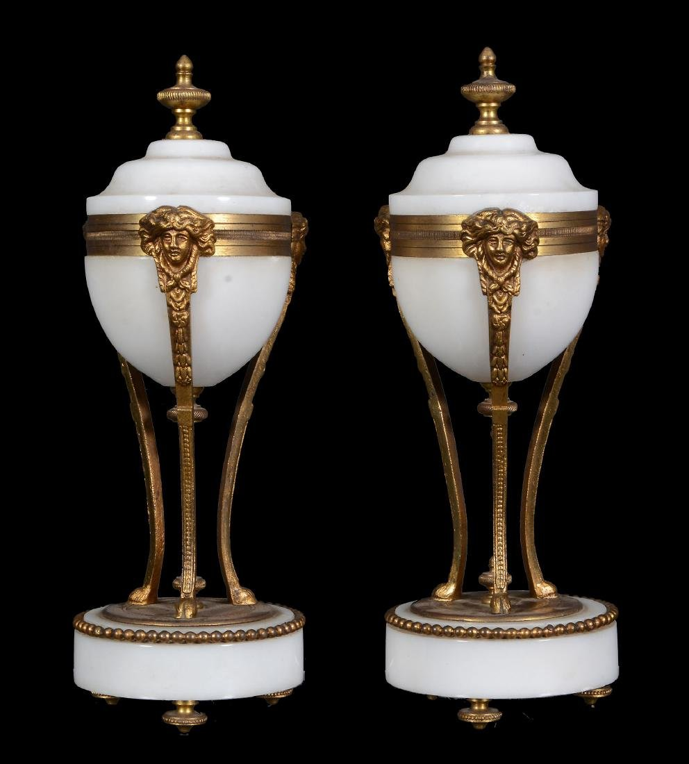 A pair of French white marble and gilt bronze mounted