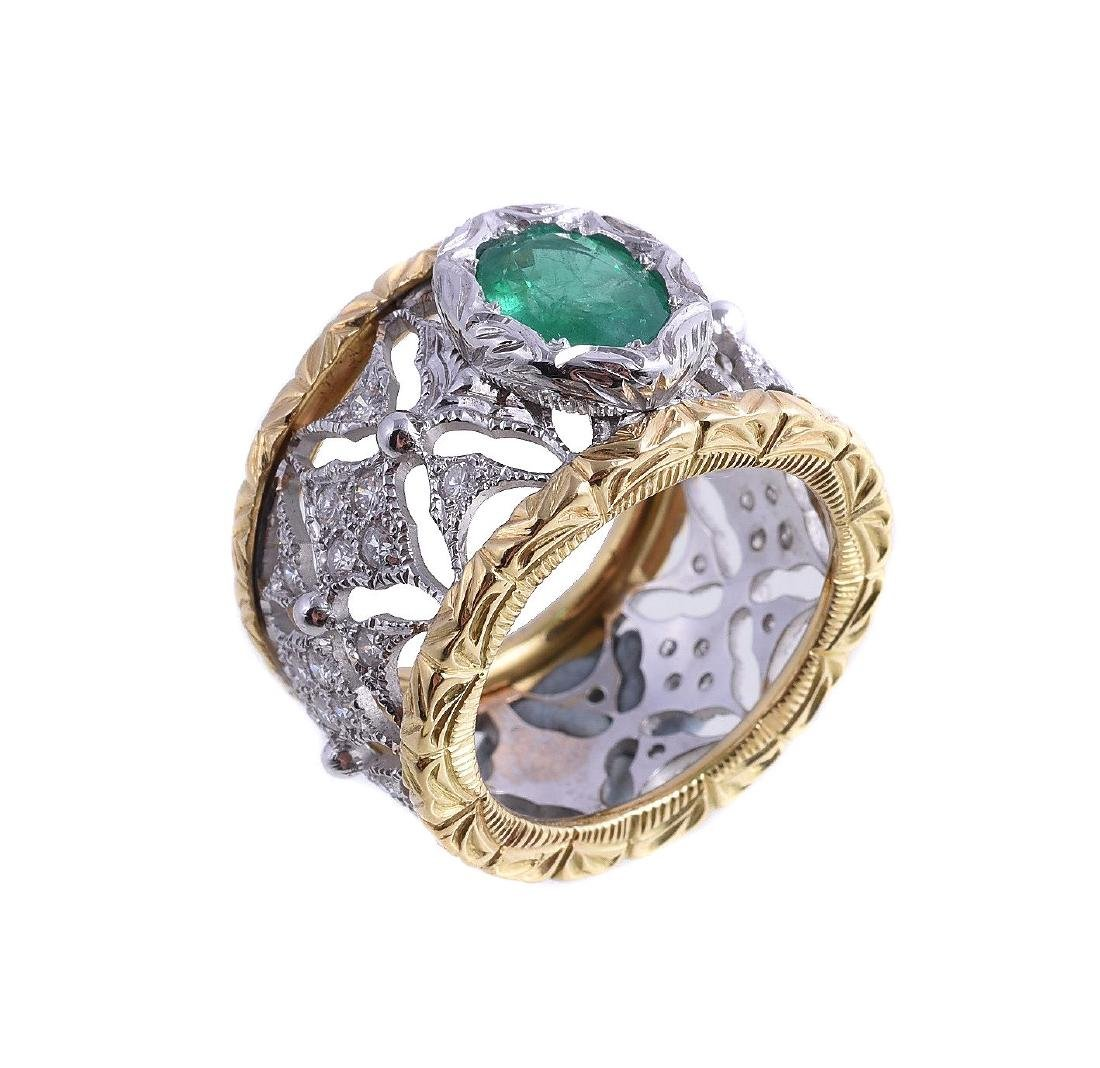 An emerald and diamond ring, the oval cut emerald