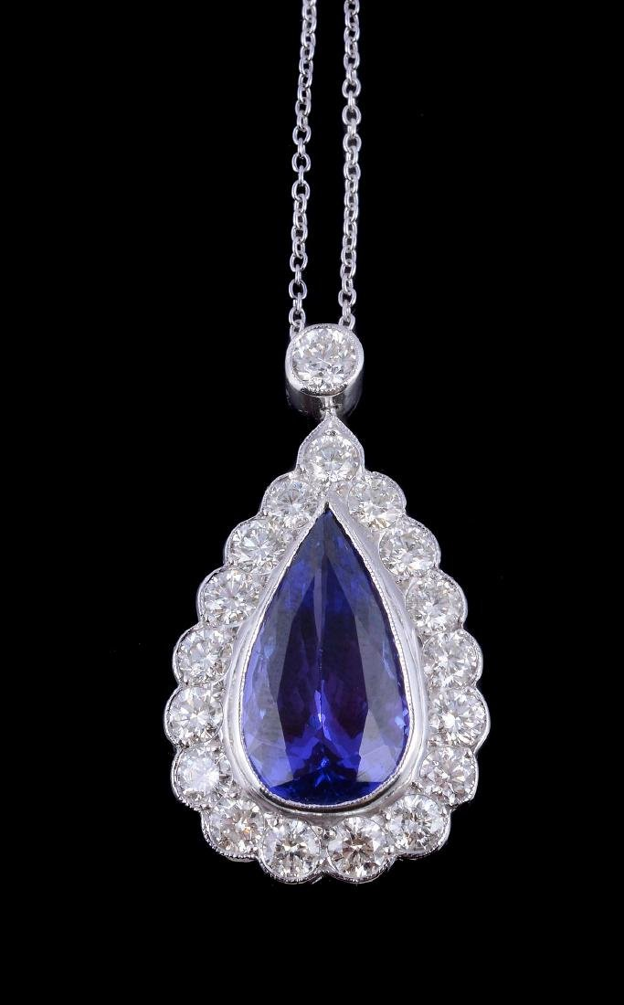 A tanzanite and diamond pendant, the pear cut tanzanite