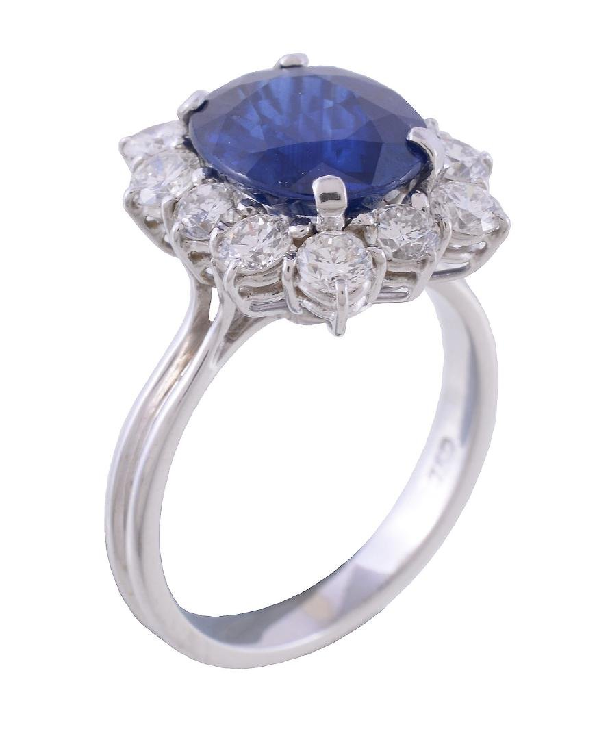 A sapphire and diamond cluster ring, the central oval
