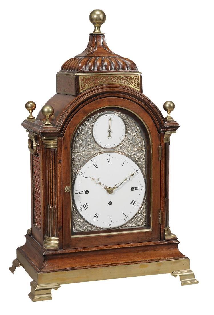 A fine George III brass mounted mahogany quarter