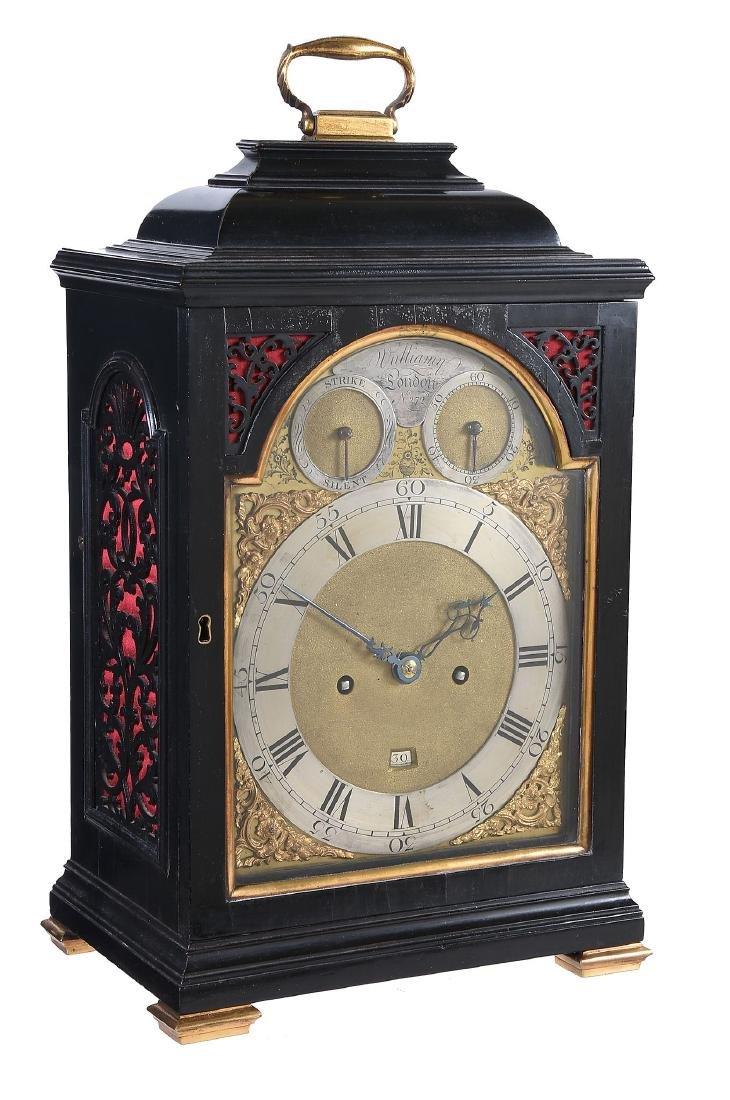 A fine George III ebonised table clock with