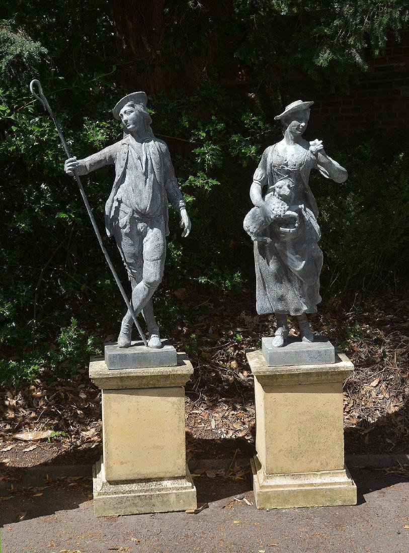 A pair of cast lead garden models of a shepherd and a