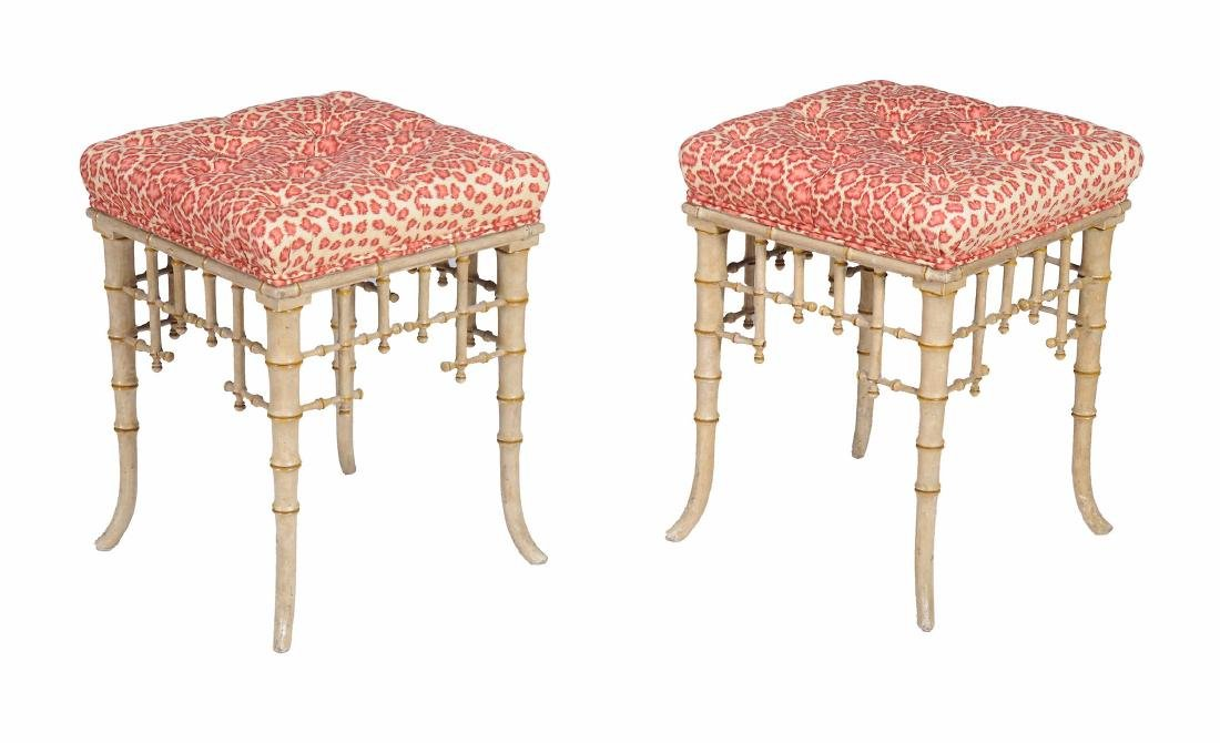 A pair of painted and parcel gilt stools in 'Brighton
