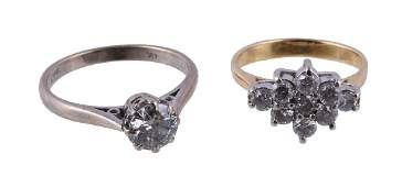 A diamond cluster ring, the marquise shaped cluster set