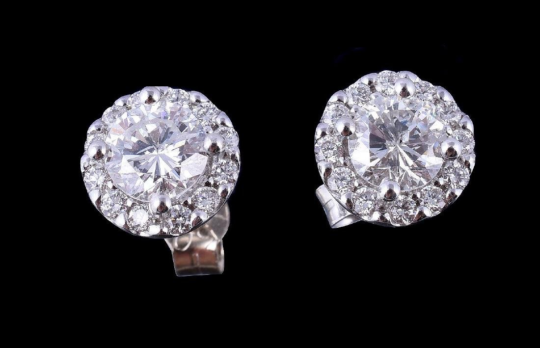 A pair of diamond cluster earrings, the central