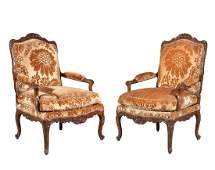 A pair of Louis XV carved walnut armchairs , circa 1730